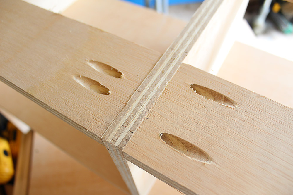 Using pocket holes to connect wood when making a DIY entryway bench