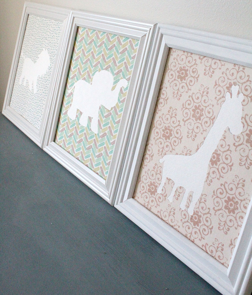 White picture frames with baby animal prints - easy DIY project for the nursery