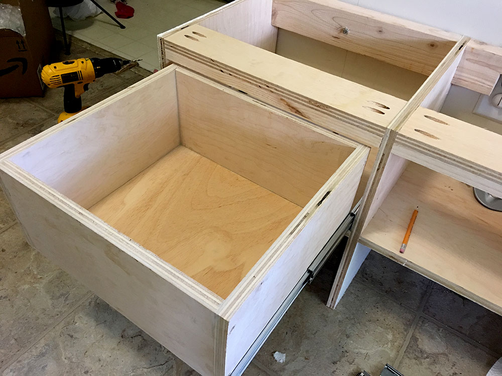 Connecting drawers to openings for a homemade DIY entryway bench with storage