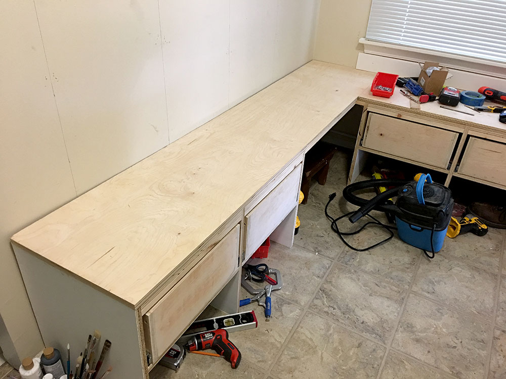 Securing the benchtop to the wall and cubbies for this DIY entryway bench tutorial