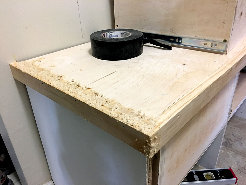 Custom-made woody putty to match the wood in building an entryway bench for the mudroom with tons of storage