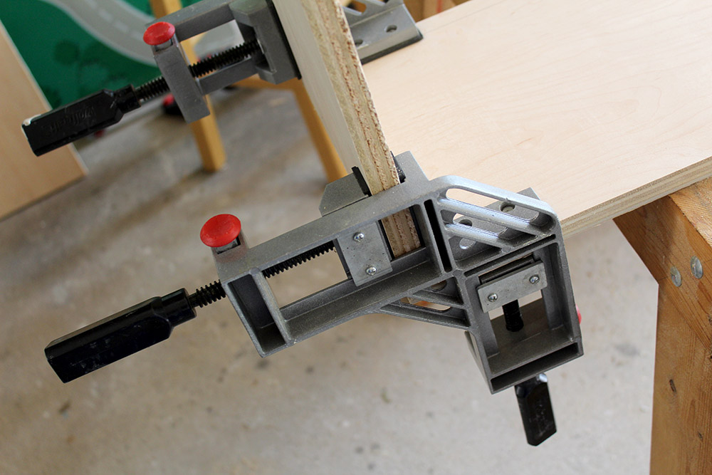 Attaching the plywood to make cubbies using clamps