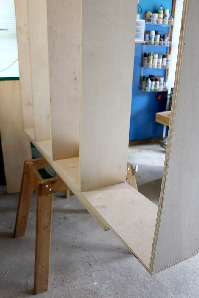 Assembling the cubbies for the entryway hall tree, with tons of storage