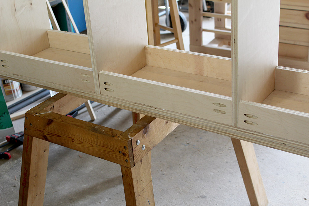 Assembling extra support on the diy cubby shelf for the entryway bench