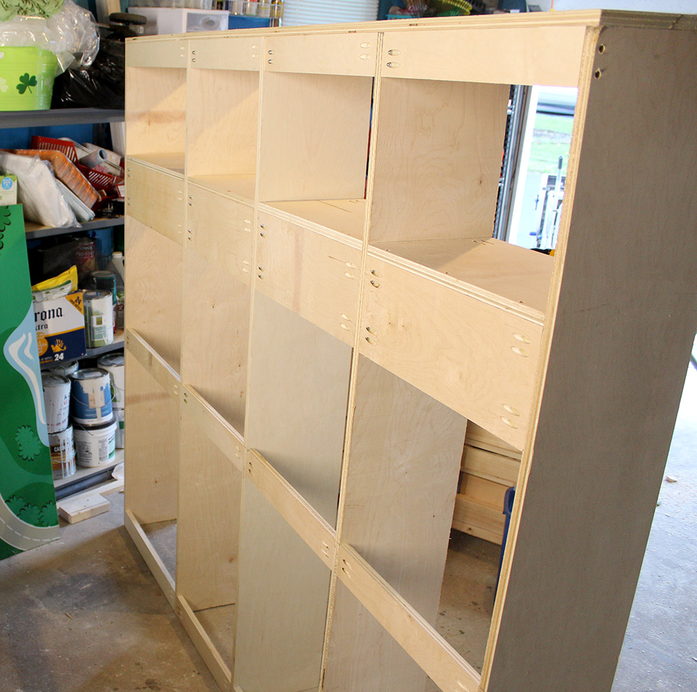 Reinforcing the cubbies with extra wood for the entryway storage bench with locker-style cubbies project
