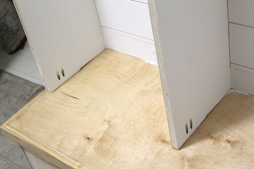 Using pocket hole screws to hold the upper locker-style cubbies in place