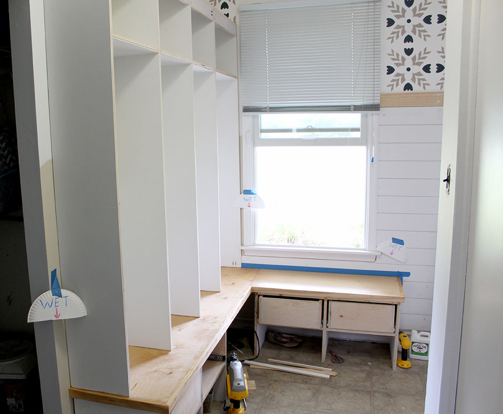 Installing an entryway bench with cubbies and drawers in the mudroom