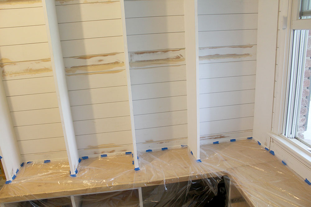 Installing shiplap in between the cubbies for a modern farmhouse look