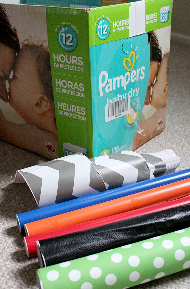 Upcycling a diaper box into DIY storage with various rolls of contact paper
