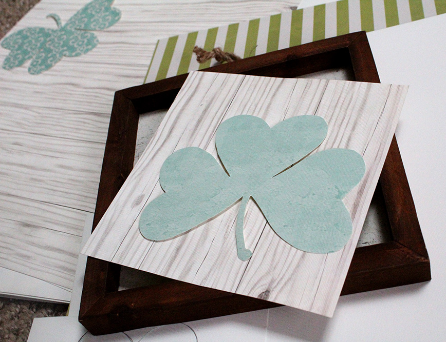 Making a shamrock on a faux white wood background for DIY St. Patrick's Day decor