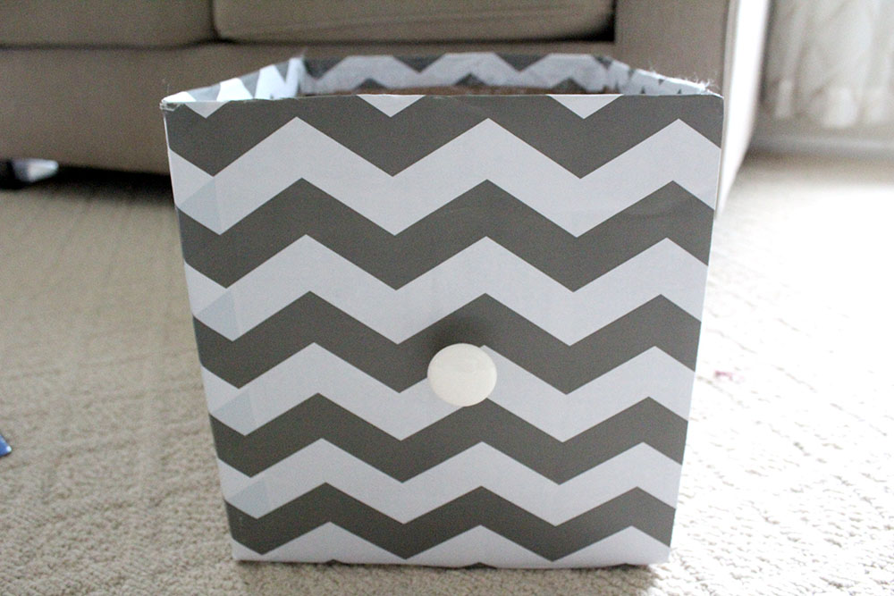 Upcycled cardboard box into DIY storage cube for home organization