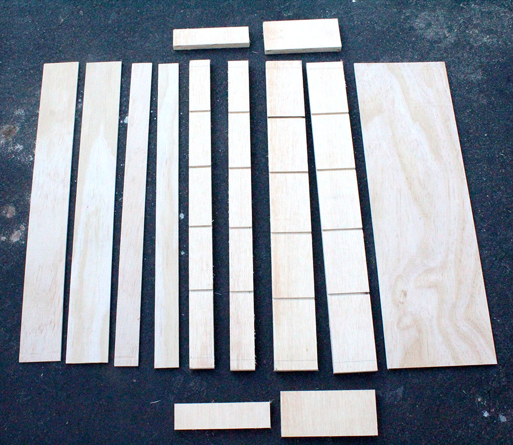 Pieces of wood needed to build custom DIY storage shelf with swing out shelves