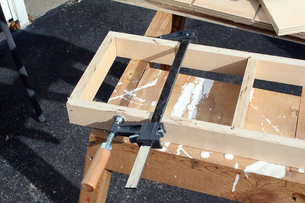 Clamping together plywood strips for diy swing out shelves - easy storage solution
