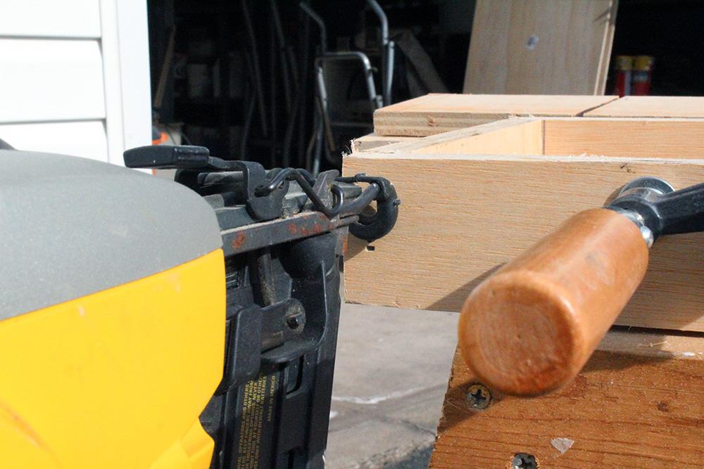 Using the nail gun to make DIY storage shelves