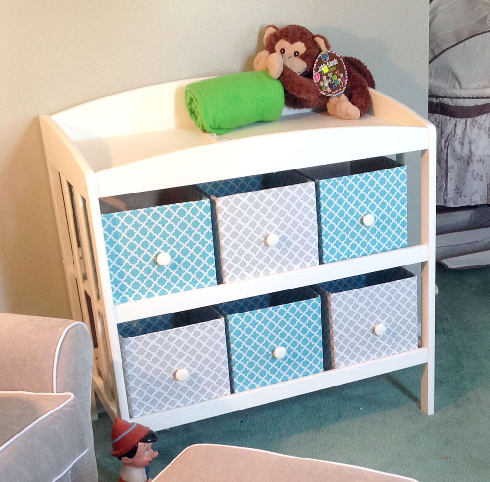 DIY storage bins on changing table for thrifty nursery ideas