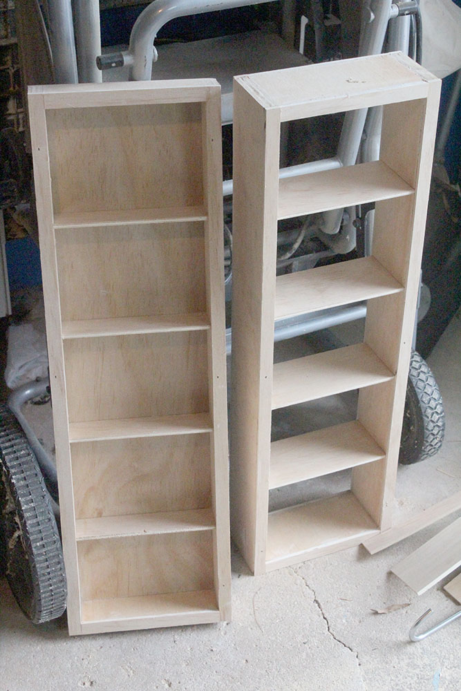 DIY wall mounted shelving with a swinging shelf for additional storage