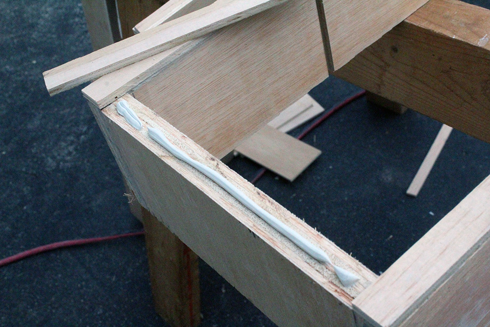 Adding trim to the plywood wall shelf