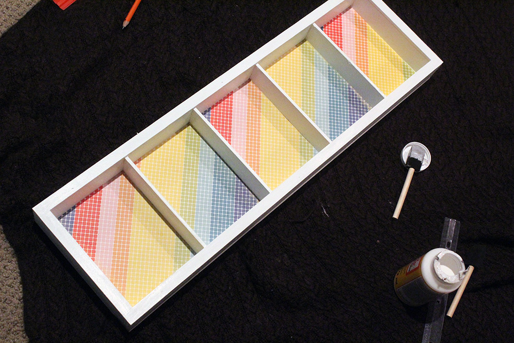 Using colorful card stock on the back of DIY shelving