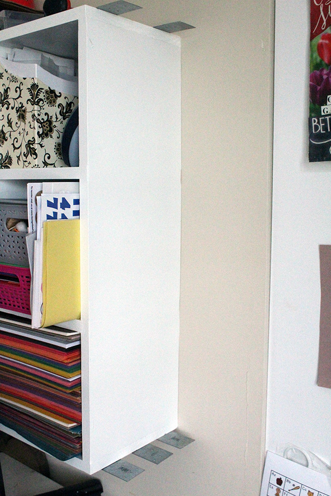 Adding a DIY wall cabinet to the end of a wall-mounted cubby shelf