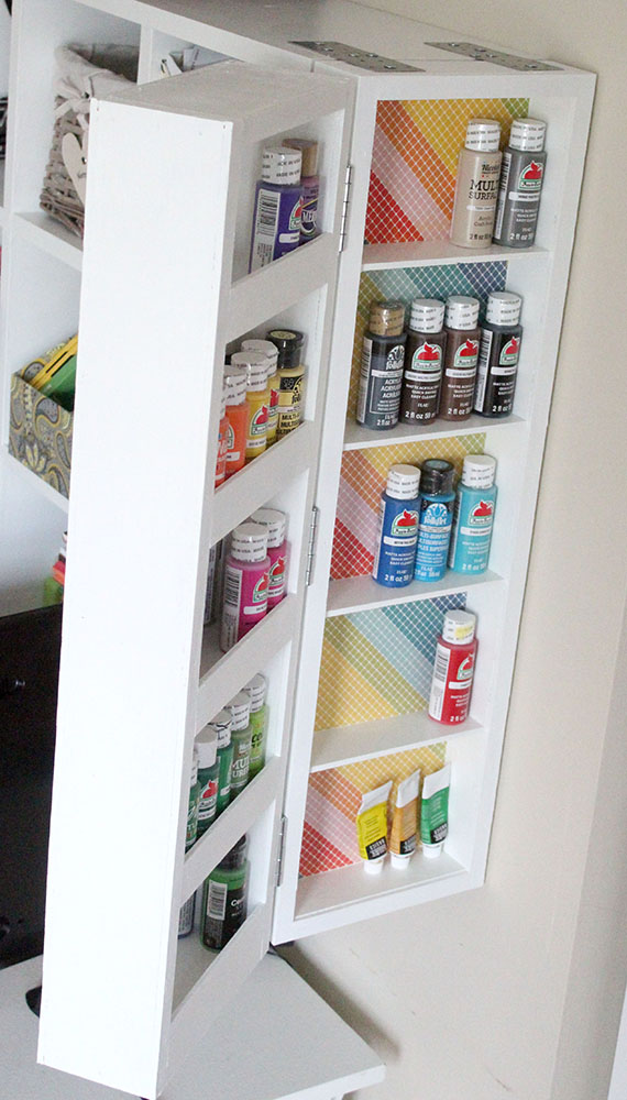 DIY acrylic paint organizer mounted on the wall