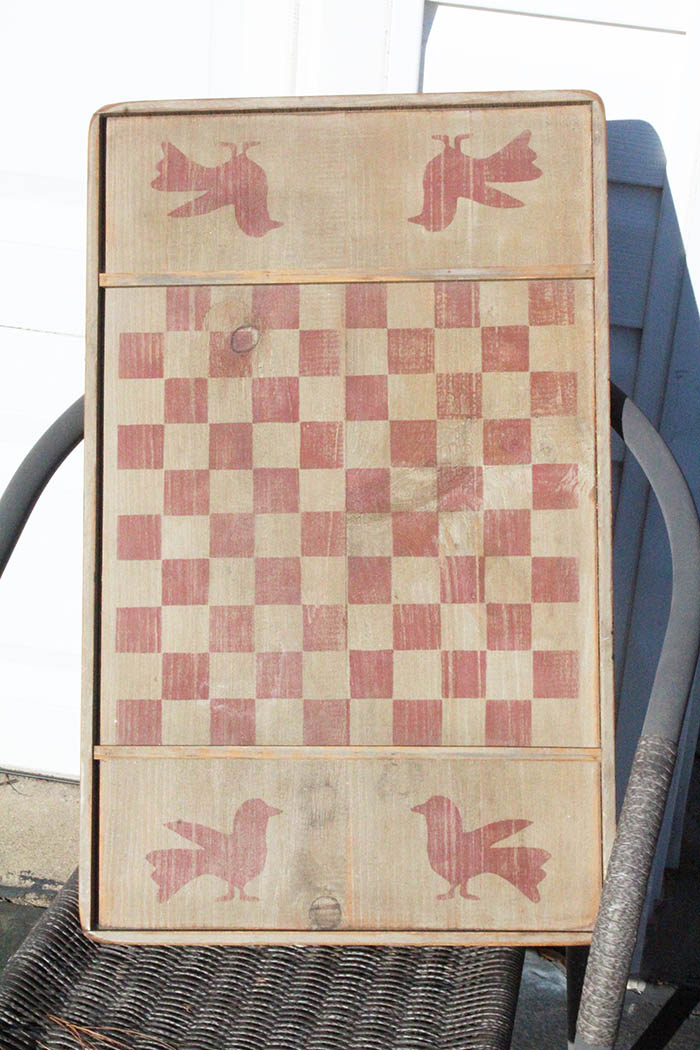 Old rustic handpainted checkerboard game to be turned into an end table