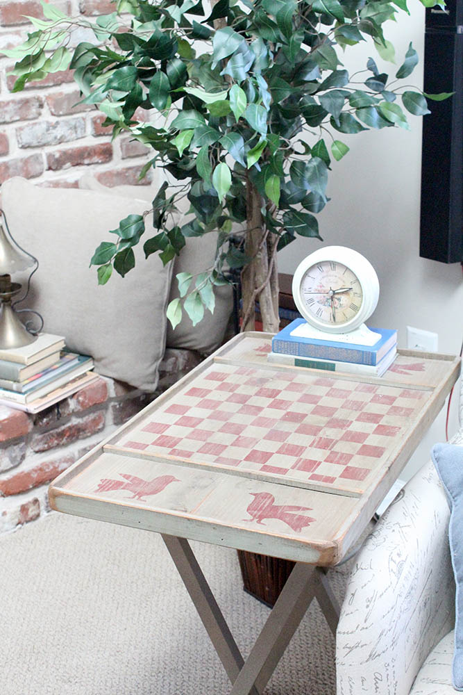 Rustic checkerboard end table repurposed from an old TV tray table