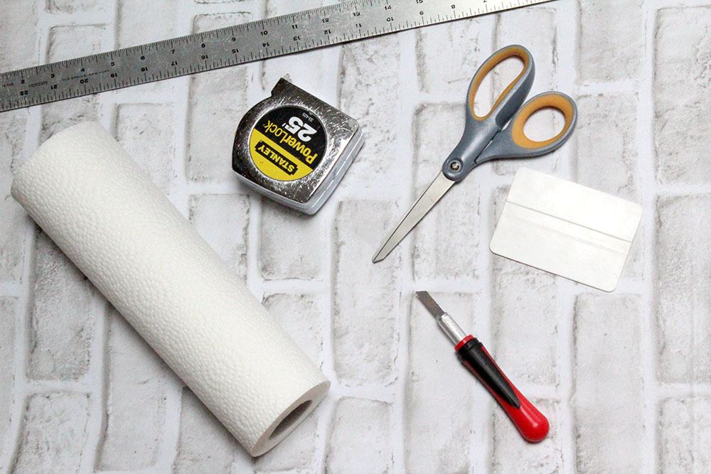 Picture of materials needed to apply DIY peel and stick wallpaper