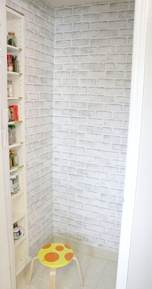 Putting up DIY wallpaper in a kitchen pantry closet for an easy upgrade before new DIY shelving system goes in