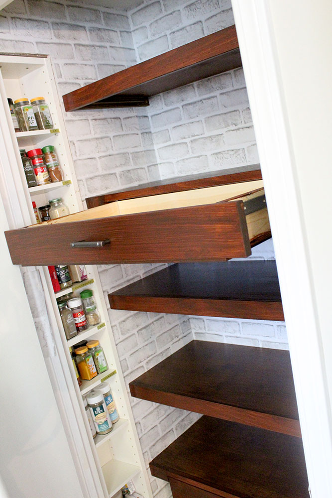 Kitchen pantry update with new peel and stick wallpaper and floating shelves and drawers
